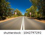 a country road meandering... | Shutterstock . vector #1042797292