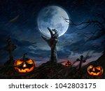 Zombie hands rising in dark...