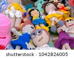 colorful handmade knitted dolls....   Shutterstock . vector #1042826005