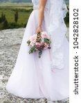 pink peonies wedding bouquet in ... | Shutterstock . vector #1042828102