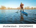 senior male paddling a...   Shutterstock . vector #1042858402