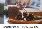 chef serves the salad by... | Shutterstock . vector #1042862122