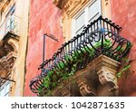balcony of an ancient building... | Shutterstock . vector #1042871635