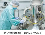 pharmaceutical factory woman... | Shutterstock . vector #1042879336