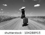lonely girl with suitcase at... | Shutterstock . vector #104288915