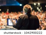 female speaker giving a talk on ... | Shutterstock . vector #1042900222