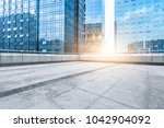 modern buildings and empty... | Shutterstock . vector #1042904092