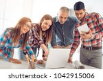 successful young design team... | Shutterstock . vector #1042915006