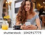 brunette beautiful woman rests... | Shutterstock . vector #1042917775