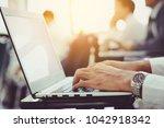 man's hands using laptop with... | Shutterstock . vector #1042918342