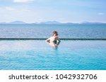 outdoor summer portrait of... | Shutterstock . vector #1042932706