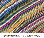 fabrics of india. india's... | Shutterstock . vector #1042947922