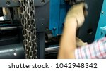 a worker is setting up a steel... | Shutterstock . vector #1042948342