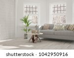 white room with sofa and winter ... | Shutterstock . vector #1042950916