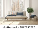white room with sofa and winter ... | Shutterstock . vector #1042950922