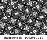 ornament with elements of black ...   Shutterstock . vector #1042957216