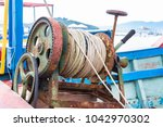 an old manual oxided winch... | Shutterstock . vector #1042970302