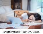 asian lady work hard and... | Shutterstock . vector #1042970836