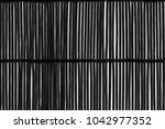black bamboo mat on white... | Shutterstock . vector #1042977352