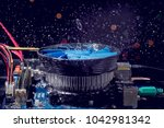 Small photo of Cleaning the maternal - the motherboard is a stream of water on the running fan