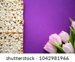 matzah for passover and pink... | Shutterstock . vector #1042981966