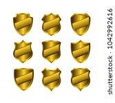 vector golden shields set ...   Shutterstock .eps vector #1042992616