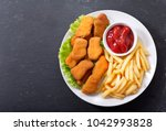 Plate Of Chicken Nuggets With...