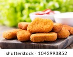 chicken nuggets with sauces on... | Shutterstock . vector #1042993852