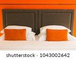 empty modern bed in bedroom | Shutterstock . vector #1043002642