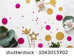 confetti. festive mood. flatlay ... | Shutterstock . vector #1043015902