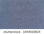 background of knitted texture... | Shutterstock . vector #1043020825
