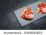 italian prosciutto crudo or... | Shutterstock . vector #1043032822