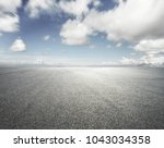 empty road with cloudy sky... | Shutterstock . vector #1043034358