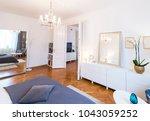 elegant and luxury bedroom... | Shutterstock . vector #1043059252