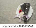 festive table setting on silver ... | Shutterstock . vector #1043063062