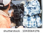 in the back of camera team... | Shutterstock . vector #1043064196