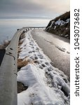 mountain road in winter  curve... | Shutterstock . vector #1043073682