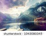 amazing alpine valley in... | Shutterstock . vector #1043080345