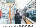 young woman outdoor using smart ... | Shutterstock . vector #1043085262