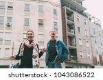 two young women outdoors having ... | Shutterstock . vector #1043086522