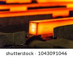 hot square steel bloom on the... | Shutterstock . vector #1043091046