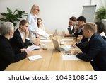 dissatisfied senior woman boss... | Shutterstock . vector #1043108545