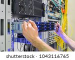 installation of a new server in ... | Shutterstock . vector #1043116765