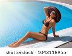 beautiful girl in outdoor pool | Shutterstock . vector #1043118955