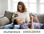 mobile addiction concept  young ... | Shutterstock . vector #1043120455