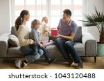 receiving present on fathers... | Shutterstock . vector #1043120488