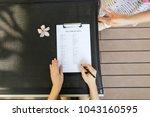 sunlight portrait of woman fill ...   Shutterstock . vector #1043160595