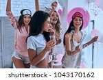 going crazy. four attractive... | Shutterstock . vector #1043170162