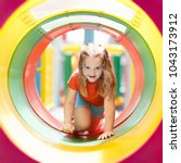 kids climbing and sliding on... | Shutterstock . vector #1043173912
