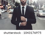 confident businessman.... | Shutterstock . vector #1043176975